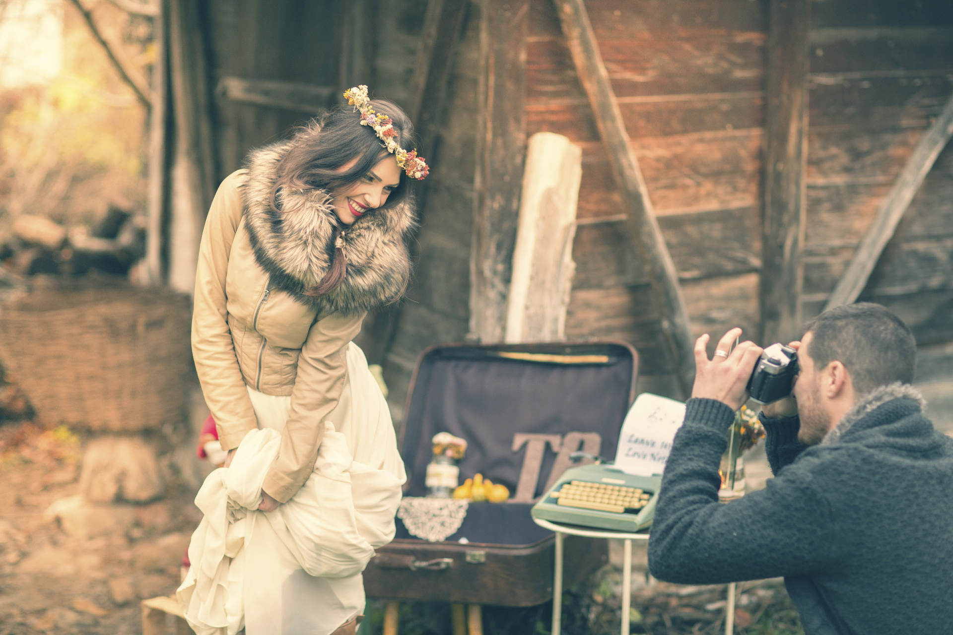 Groom photographing his bride
